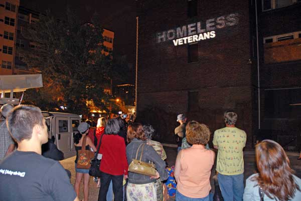 The words of the veterans being shot onto the wall of a homeless shelter